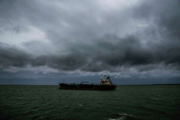 Storm clouds brew over a cargo ship as Tropical Storm Cindy approaches the coast Wednesday on the Bolivar Peninsula.