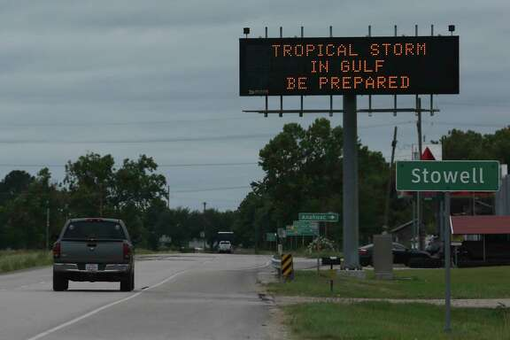 A sign warns motorists about Tropical Storm Cindy Wednesday, June 21, 2017 in Stowell  ( Michael Ciaglo / Houston Chronicle )
