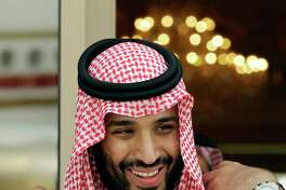 FILE - In this May 14, 2012 file photo, Prince Mohammed bin Salman waits for Gulf Arab leaders ahead of the opening of Gulf Cooperation Council summit, in Riyadh, Saudi Arabia.Saudi Arabia's King Salman has appointed his 31-year-old son Mohammed bin Salman as crown prince, removing the country's counterterrorism czar and a figure well-known to Washington from the royal line of succession. In a series of royal decrees issued Wednesday, June 21, 2017 and carried on the state-run Saudi Press Agency, the monarch stripped Prince Mohammed bin Nayef, who was first in line to the throne, from his title as crown prince and from his post as the country's powerful interior minister overseeing security. (AP Photo/Hassan Ammar, File)