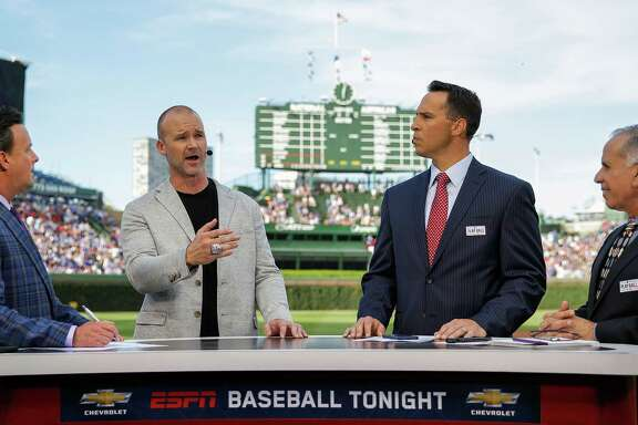 "David Ross, second from left, is keeping busy in ""retirement"" since  going out on top as a player with the 2016 Cubs."