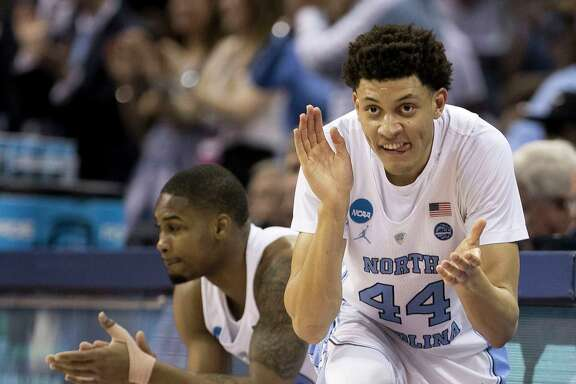 North Carolina's Justin Jackson (44) applauds an early North Carolina lead  against Butler in the NCAA Tournament South Regional semifinal at FedExForum in Memphis, Tenn., on March 24, 2017. (Robert Willett/Raleigh News & Observer/TNS)