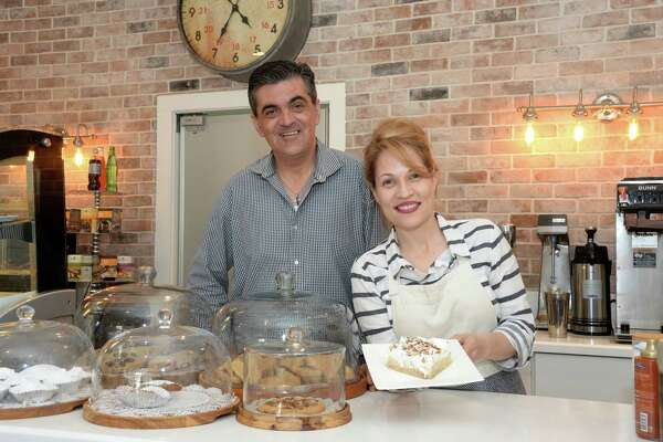 Owners Tasos and Patricia Pantazopoulos serve up a pastry called Ekmeik at Anonymous Cafe, Houston, TX on June 19, 2017.