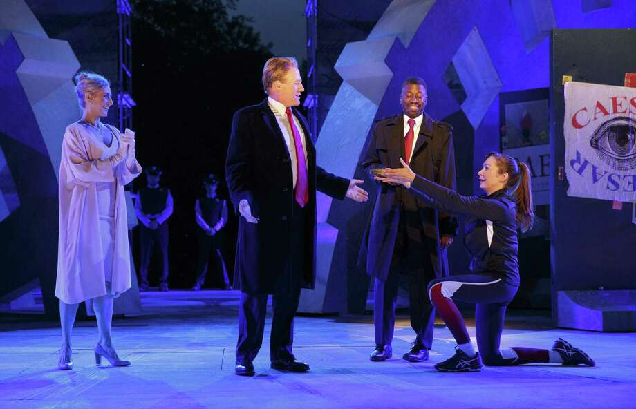 Tina Benko, left, portrays Melania Trump in the role of Caesar's wife, Calpurnia, and Gregg Henry, center left, portrays President Donald Trump in the role of Julius Caesar during a dress rehearsal of The Public Theater's Free Shakespeare in the Park production of Julius Caesar in New York. The drama has implications for today. Beware the Ides of March. Photo: Joan Marcus /Associated Press / The Observer
