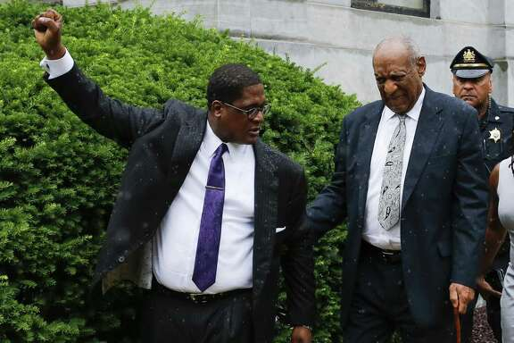 Bill Cosby's greatness was that people, through him, could see themselves and the nation in a better light. No more. Here, he leaves the courthouse in Norristown, Pa., last week as Andrew Wyatt, his spokesman, celebrates the mistrial.