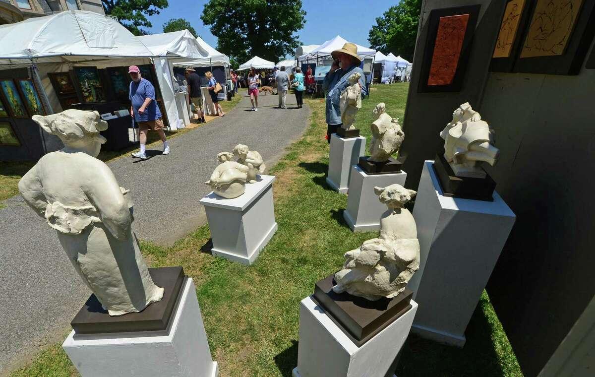 David Bryce displays his ceramic sculptures at the 4th Annual Norwalk Art Festival in June 2016 at Mathews Park in Norwalk.