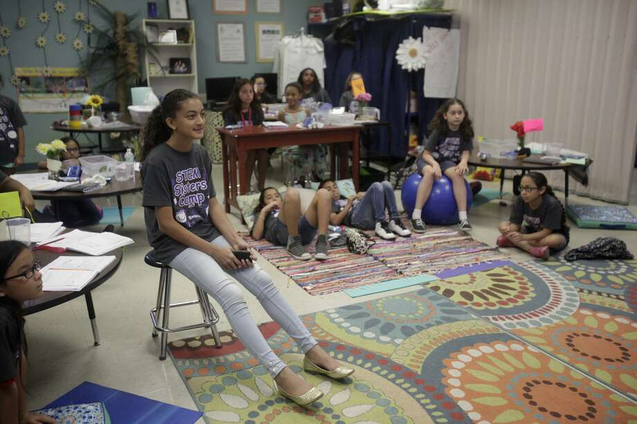 nICOLE bIR, 11, A FIFTH GRADE STUDENT OF Ed Cody Elementary School in San Antonio, Listens to the instructions provided by instructor Lisa Rollins about how to finish constructing the submersible. The submersible was a project to teach the students about the concept of mass and volume of objects. Photo: Srijita Chattopadhyay, Staff / San Antonio Express-News / © 2017 San Antonio Express-News