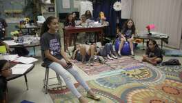 nICOLE bIR, 11, A FIFTH GRADE STUDENT OF Ed Cody Elementary School in San Antonio, Listens to the instructions provided by instructor Lisa Rollins about how to finish constructing the submersible. The submersible was a project to teach the students about the concept of mass and volume of objects.