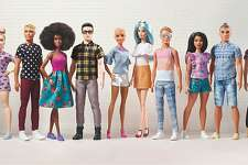 A group photo of the redesigned Ken and Barbie dolls.
