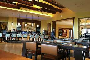 The lounge and bar of 18 Oaks, the steakhouse at the JW Marriott San Antonio Hill Country Resort & Spa.