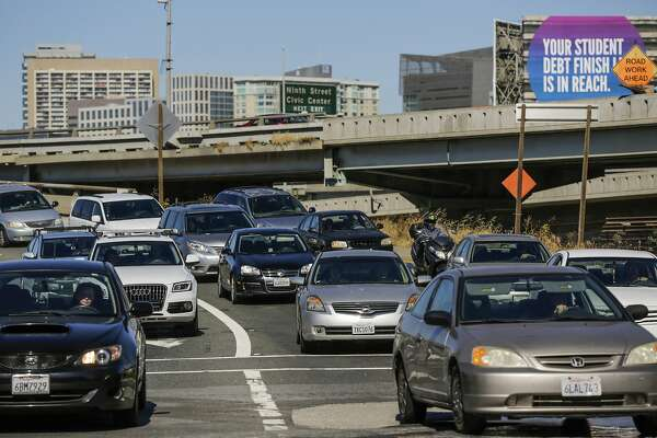 Vehicles exit Highway CA-101 at 4th and Bryant Streets in San Francisco, Calif., on Sunday, June 18, 2017. The eastbound lanes of the Bay Bridge were closed early Sunday morning following a police-involved shooting and did not reopen until 9am Sunday. Authorities say San Francisco's Bay Bridge was partially shut down for hours after officers responding to a crash shot and wounded a motorist who drove at them. The California Highway Patrol says the collision was reported around 3:30 a.m. Sunday. (Gabrielle Lurie/San Francisco Chronicle via AP)