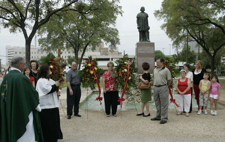Father Ed Kelly (left) oversees a 2008 ceremony as the San Antonio Christopher Columbus Italian Society commemorates the 15th century explorer's 1492 voyage to the New World. Archaeologists now believe the area was the first site of the Mission San Antonio de Valero in 1718. Photo: Express-News File Photo / THE SAN ANTONIO EXPRESS-NEWS