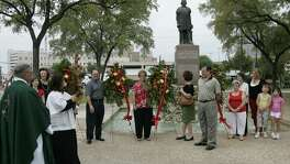 Father Ed Kelly (left) oversees a 2008 ceremony as the San Antonio Christopher Columbus Italian Society commemorates the 15th century explorer's 1492 voyage to the New World. Archaeologists now believe the area was the first site of the Mission San Antonio de Valero in 1718.