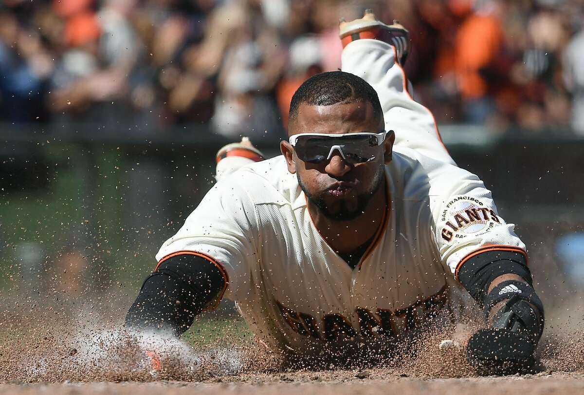 SAN FRANCISCO, CA - JUNE 11: Eduardo Nunez #10 of the San Francisco Giants scores against the Minnesota Twins in the bottom of the seventh inning at AT&T Park on June 11, 2017 in San Francisco, California. (Photo by Thearon W. Henderson/Getty Images)