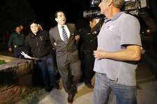 Crystal City Mayor Ricardo Lopez is taken away from city hall by police after a scuffle with citizens during a heated council meeting to suspend city manager James Jonas III and to force a recall election after Jonas and three city council members were faced federal corruption charges on Tuesday, Feb. 16, 2016. (Kin Man Hui/San Antonio Express-News)