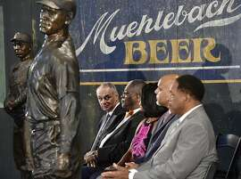 From left, Major League Baseball commissioner Robert Manfred; Kansas City Mayor Sly James; Judy Pace Flood, widow of Curt Flood; MLB Players Association Executive Director Tony Clark and former player Dave Winfield attend ceremonies  in Kansas City, Mo., Wednesday, June 21, 2017. Major League Baseball and its players' union presented a $1 million grant to the Negro League Baseball Museum to help with operating costs, expansion plans and educational opportunities. (Jill Toyoshiba/The Kansas City Star via AP)