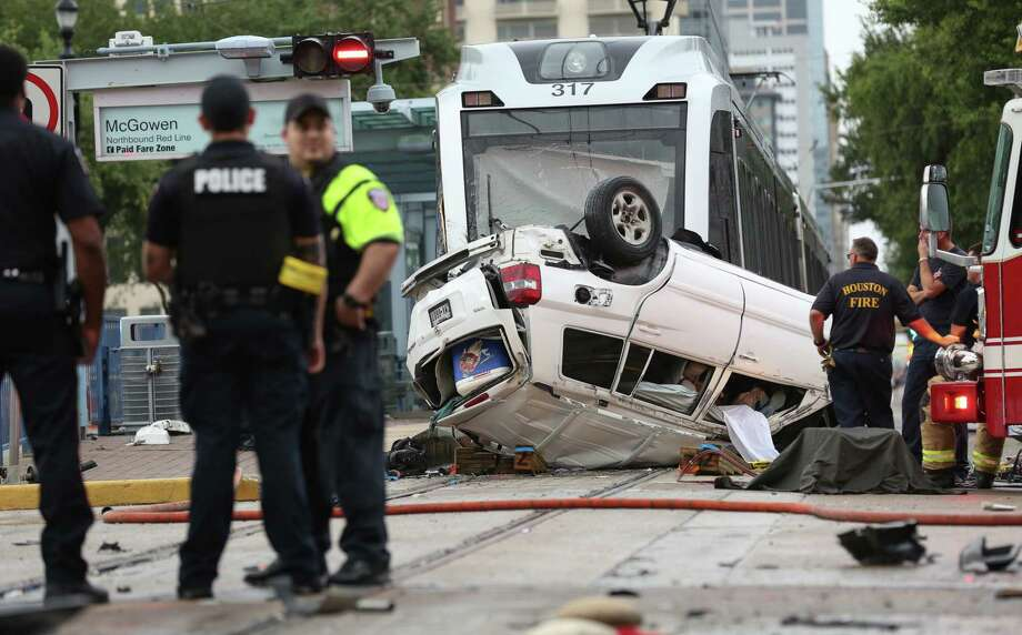 Metro Police and Houston firefighters investigate the scene of a fatal accident between three vehicles and a METRO train at the intersection of Main and McGowen streets Wednesday, June 21, 2017. . Photo: Godofredo A. Vasquez / Houston Chronicle