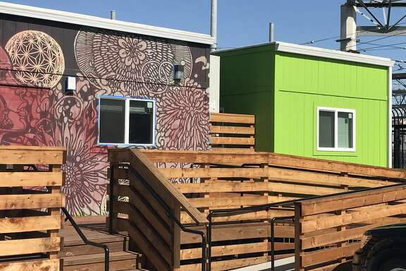The front of the Dogpatch Navigation Center at the east end of 25th Street. Unlike other homeless shelters, this one is designed to have curb appeal. Among the touches are an intricate floral mural and color-coded buildings, including lime-green for ones where residents can meet with social workers.