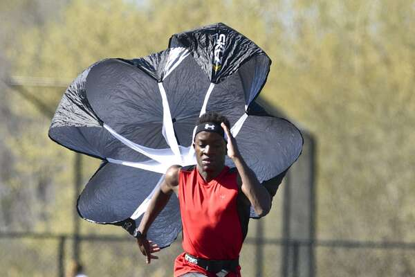 Christian Morris, 18, of Danbury, does parachute speed resistance training on the Immaculate High School track on Tuesday, April 18, 2017, in Danbury, Conn. Morris is a member of the Immaculate track team and runs the 400 meter, 800 meter and the 4x100 meter relay.