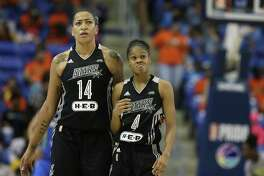 San Antonio Stars guard Moriah Jefferson (4) and forward Erika de Souza (14) head to the bench for a timeout during the second half against the Dallas Wings in Arlington on June 21, 2017. The Wings won 81-78.