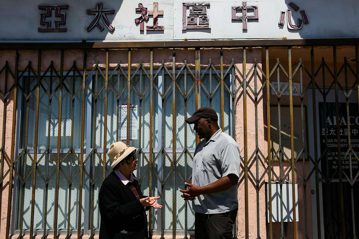 (l-r) Spokeswoman for the Visitation Valley Asian alliance Marlene Tran and community advocate Russel Morine chat as they stand for a portrait outside a building that is being proposed to become a medical marijuana dispensary in San Francisco, California, on Wednesday, June 21, 2017. They are both opposed to the dispensary.