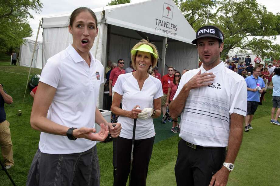 Former Connecticut basketball player Rebecca Lobo, left, reacts after being called to the first tee while talking with Connecticut basketball coach Chris Dailey, center, and golfer Bubba Watson at the Travelers Championship at TPC River Highlands, Wednesday, June 21, 2017 in Cromwell, Conn. (Mark Mirko/Hartford Courant via AP) Photo: Mark Mirko / Associated Press / ©2017 The Hartford Courant