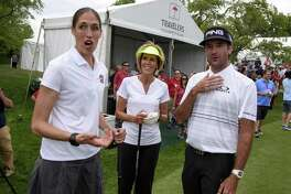 Former Connecticut basketball player Rebecca Lobo, left, reacts after being called to the first tee while talking with Connecticut basketball coach Chris Dailey, center, and golfer Bubba Watson at the Travelers Championship at TPC River Highlands, Wednesday, June 21, 2017 in Cromwell, Conn. (Mark Mirko/Hartford Courant via AP)