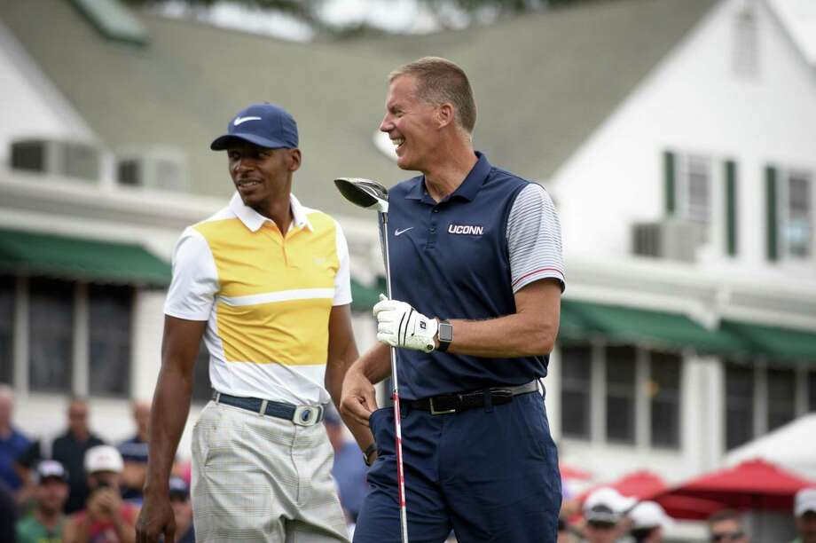 Former Connecticut basketball player Ray Allen and Connecticut football coach Randy Edsall react after hitting on the first hole at the Travelers Championship at TPC River Highlands, Wednesday, June 21, 2017 in Cromwell, Conn. (Mark Mirko/Hartford Courant via AP) Photo: Mark Mirko / Associated Press / ©2017 The Hartford Courant