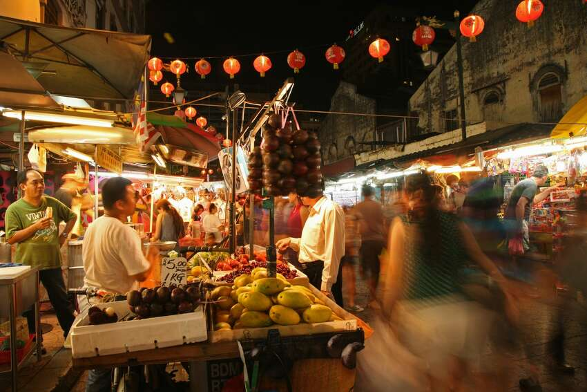 Experiencing the food in new countries is one of the exciting parts of travel. Find out which places Booking.com users said were the best places to travel, if you're a foodie in search of a vacation. Shown: A bustling food market in the Chinatown area of Kuala Lumpur in Malaysia.