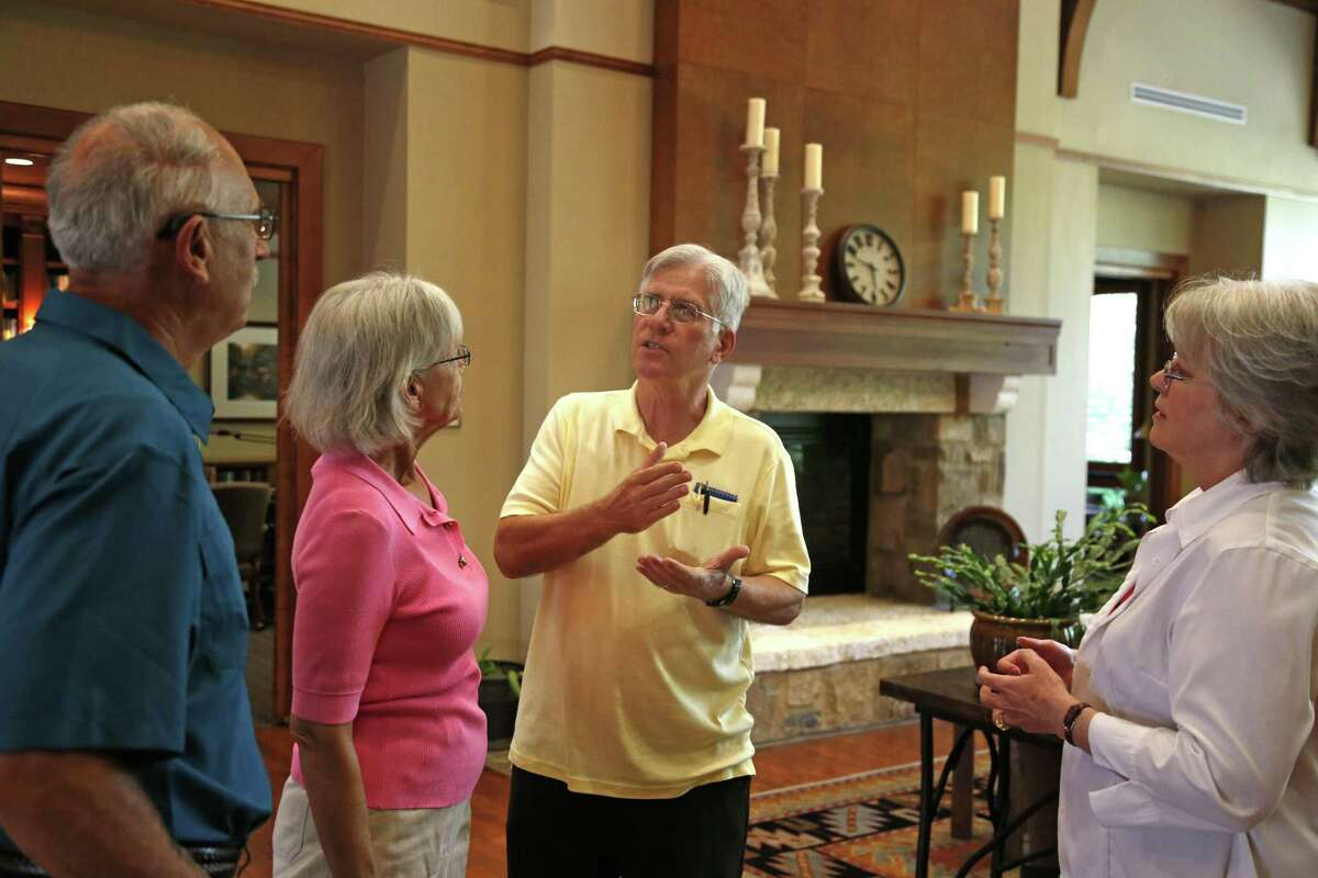 Clay Hadick, center, talks with Rick and Shirley Hill, left, as his wife, Dianna Hadick, right, listens. The Hadicks moved to Bexar County in 2012 from Princeton, New Jersey. They live in Alamo Ranch in a gated community for people 55 years old and older.