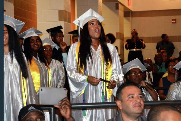 Graduate Taylor Riley reacts she watches a school highlight video during Bridge Academy's 20th Annual Commencement Exercises in Bridgeport, Conn., on Thursday June 21, 2017.