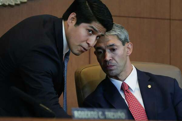 Councilman Rey Saldaña, left, chats with Mayor Ron Nirenberg after the swearing in of the new mayor on June 21. The Metropolitan Planning Organization board narrowly appointed Saldaña as its vice-chair Monday.