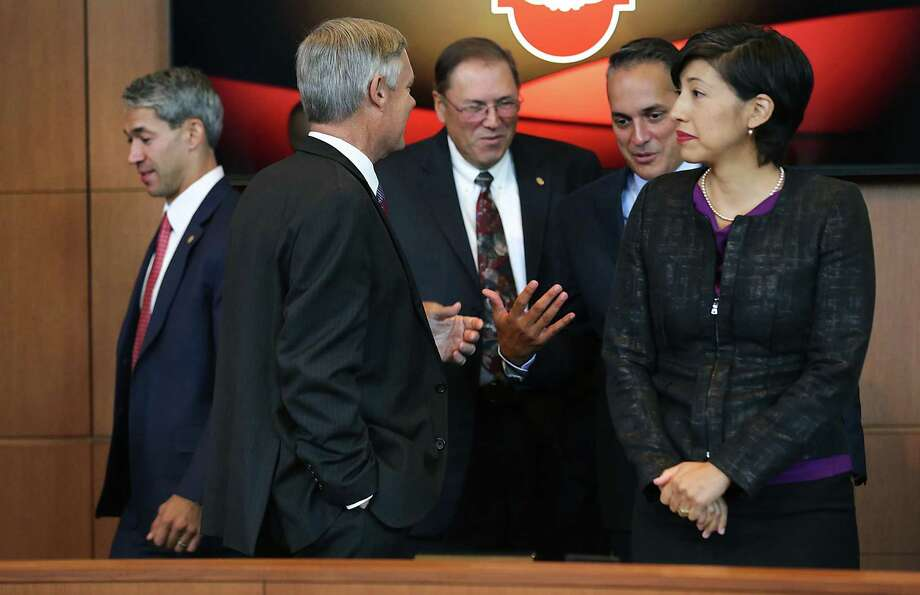 Newly sworn in Mayor Ron Nirenberg, left, walks by new city council members Clayton Perry, left to right, John Courage, Greg Brockhouse, and Ana Sandoval during a ceremony at city hall on Wednesday, June 21, 2017. Photo: Bob Owen, Staff / San Antonio Express-News / ©2017 San Antonio Express-News