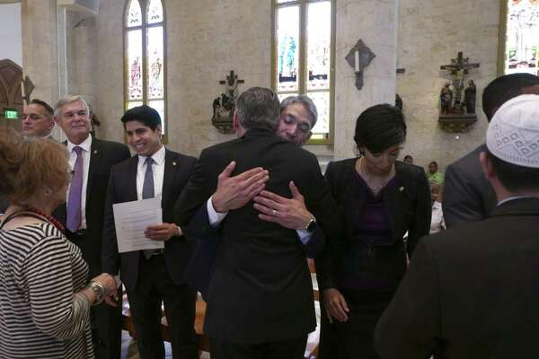 Flanked by the new City Council members, Mayor Ron Nirenberg is embraced by Archbishop Gustavo García-Siller at San Fernando Cathedral. A reader finds it disturbing that most voters could not name their City Council representative.