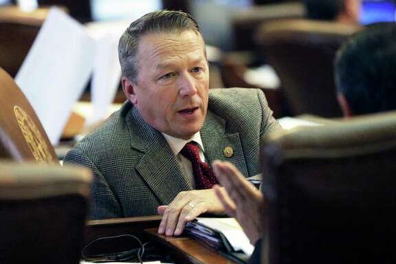 State Representative Ron Simmons, R-Carrollton, gets advice as the House version of the bathroom bill is considered on the floor on May 9, 2017.