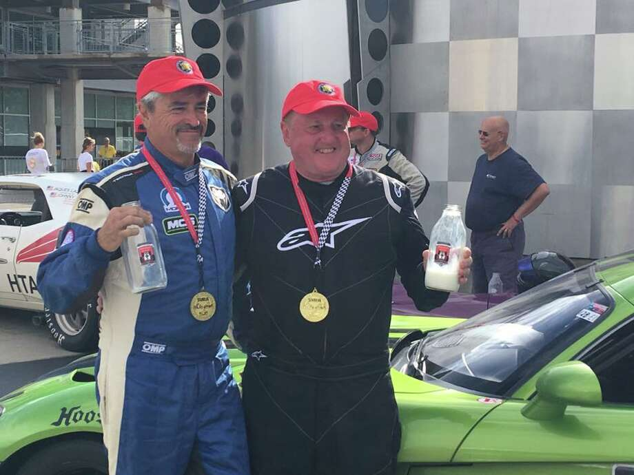 Jerry Robinson of Willis poses with Bobby Archer after they participated in the SVRA Brickyard Vintage endurance race at Indianapolis Motor Speedway this past Sunday. Photo: Photo Provided