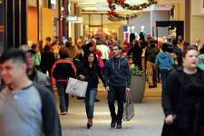 Shoppers head for stores at the Westfield Trumbull Mall on Nov. 25, 2016.