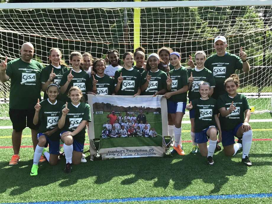 The Danbury Revolution 12-and-under girls soccer team captured the 2017 Spring CJSA Connecticut Cup. Here they are holding the banner from their Fall 2016 Connecticut Cup Championship. Pictured are (front row, from left) Nayeli Guzman, Presley Damiano, Katie Barnett and Mali Nepeman; (standing, from left to right) assistant coach Manny Catarino, Mia Pineault, Erin Bleecker, Jane Gawley, Juliana Rosas, Amajah Brandon, Cate Mullin, Tiana Taft, Dilia Lebron, Eliana Betancourt-Colon, Mya Pellicone, Natalia Catarino and head coach Michael Diker. Photo: Contributed Photo / Contributed Photo