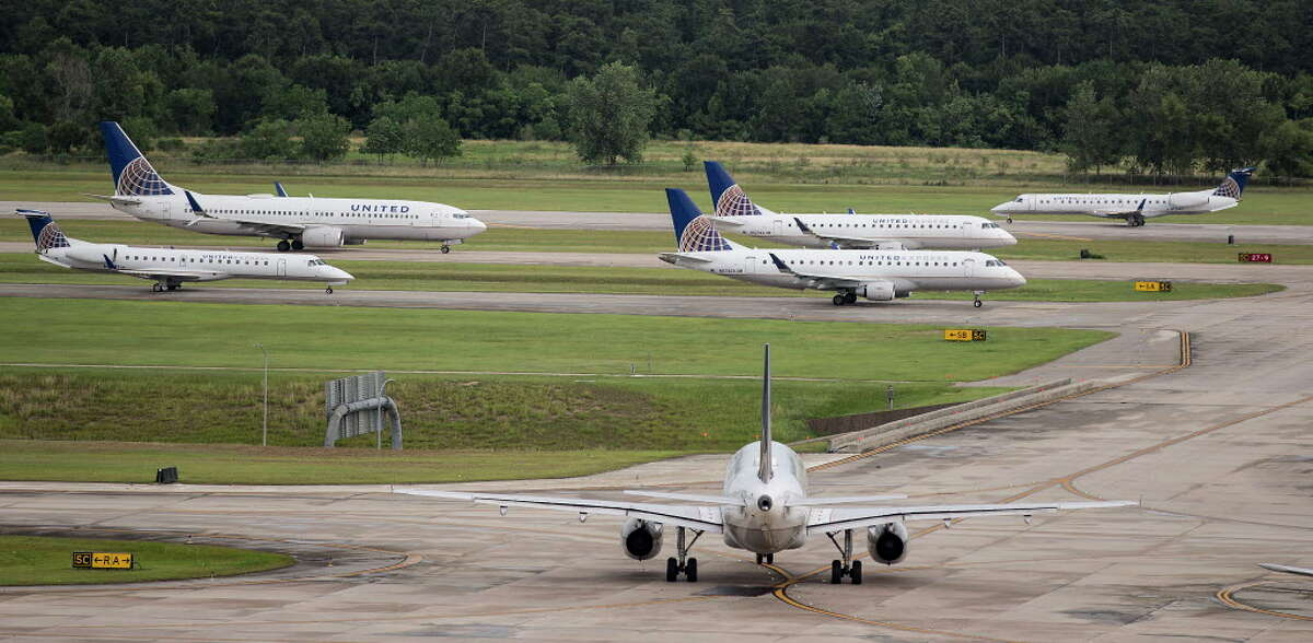 Airplanes are lined up on the tarmac at George Bush Intercontinental Airport on Wednesday, June 21, 2017, in Houston. Flights were delayed departing from Bush Airport due to the wind.