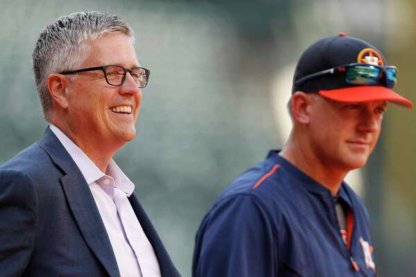 The Astros' 13-game lead in the AL West affords general manager  Jeff Luhnow, left, and skipper A.J. Hinch much patience in roster upgrades.