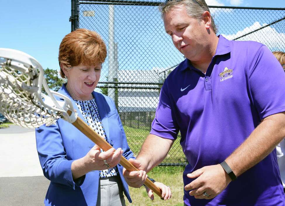 Mayor Kathy Sheehan gets some pointers from UAlbany lacrosse coach Scott Marr before the announcing the launch of the Lacrosse Communities Project ceremony at Albany High School Wednesday June 21, 2017 in Albany, NY. Albany will be the first of several cities across the country to implement the national lacrosse mentoring program which aims to provide opportunities for urban youth through the early introduction to Lacrosse. (John Carl D'Annibale / Times Union)