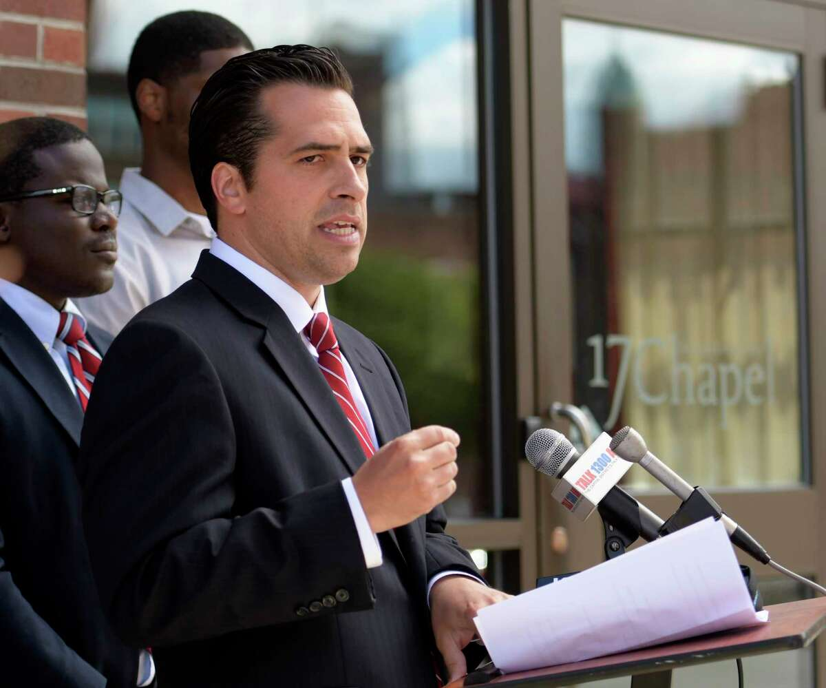 Mayoral candidate Frank Commisso Jr. calls out Albany Mayor Kathy Sheehan for alleged improper tax abatements Wednesday June 21, 2017 during a press conference in front of 17 Chapel Street in Albany, N.Y. (Skip Dickstein/Times Union)