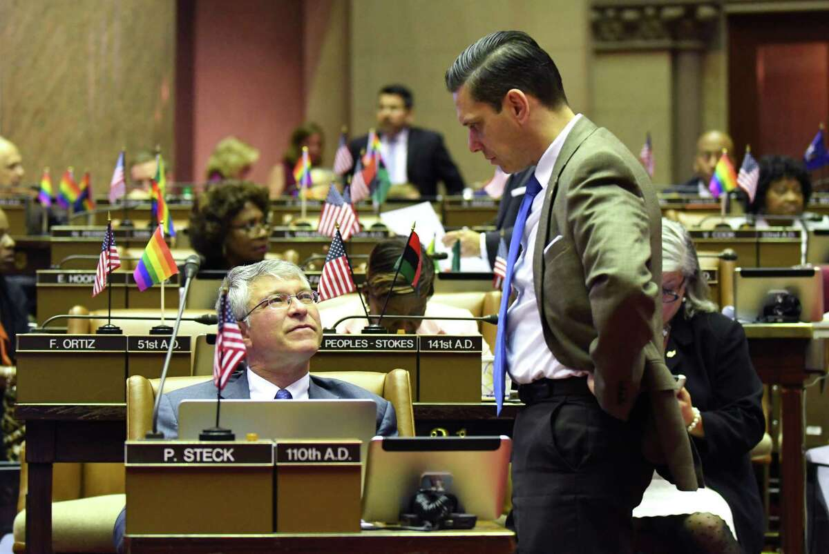 Assemblyman Angelo Santabarbara, right, stops by Assemblymember Phil Steck?'s desk to talk during session in the Assembly on Wednesday, June 21, 2017, at the Capitol in Albany, N.Y. (Will Waldron/Times Union)