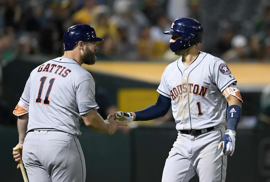 OAKLAND, CA - JUNE 21:  Carlos Correa #1 of the Houston Astros is congratulated by Evan Gattis #11 after Correa hit a solo home run against the Oakland Athletics in the top of the ninth inning at Oakland Alameda Coliseum on June 21, 2017 in Oakland, California. The Astros won the game 5-1.  (Photo by Thearon W. Henderson/Getty Images) Photo: Thearon W. Henderson/Getty Images