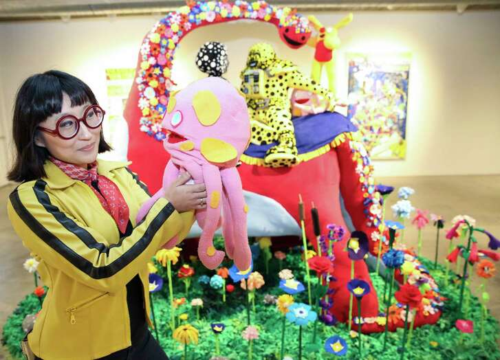 """Artist Joo Young Choi poses for a portrait with Putt-Putt, a character from a world that she created, next to her """"Time for You and Joy to Get Acquainted"""" artwork for the """"A Better Yesterday"""" exhibition at Contemporary Arts Museum Houston Friday, May 19, 2017, in Houston."""