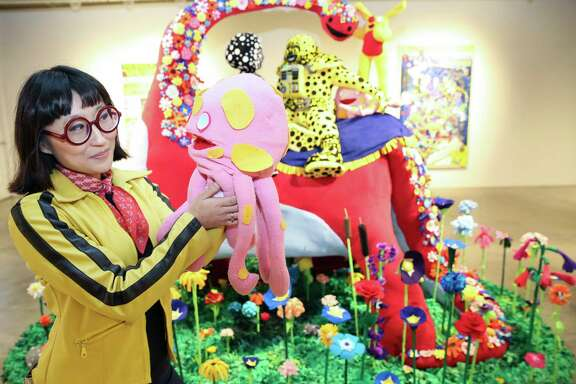 "Artist Joo Young Choi poses for a portrait with Putt-Putt, a character from a world that she created, next to her ""Time for You and Joy to Get Acquainted"" artwork for the ""A Better Yesterday"" exhibition at Contemporary Arts Museum Houston Friday, May 19, 2017, in Houston."
