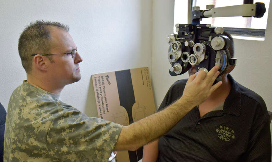 Captain Rolando Ortiz assists Lucio Torres with helping him find the right prescription for his glasses as part of the Operation Health & Wellness in collaboration with Texas A& Colonias Program, Army Reserve and Webb County at Larga Vista Community Center. The  7458th Medical Backfield Battalion in collaboration with the Texas A& systems provided medical, dental, and optometry services to the patients that arrived at the center. Photo: Ulysses S. Romero/Laredo Morning Times
