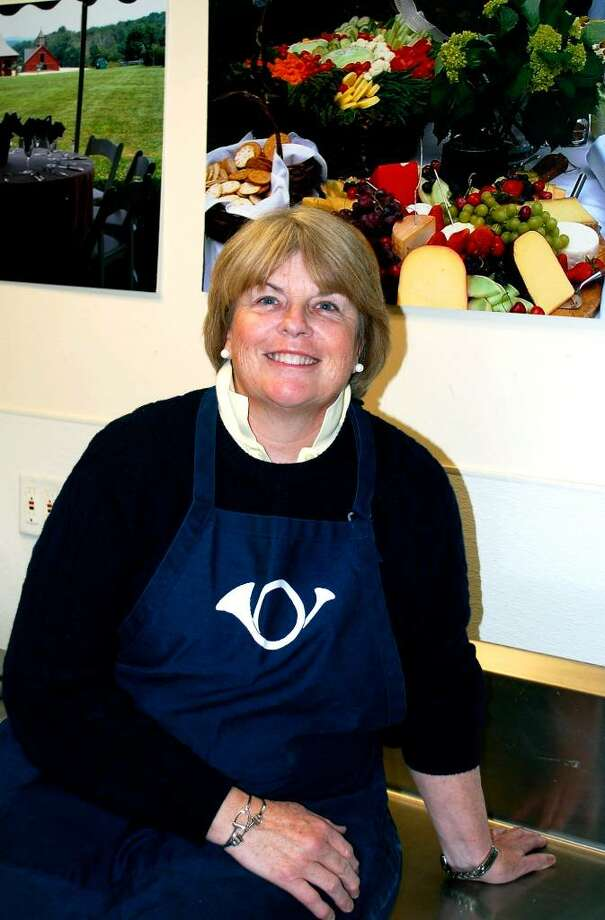 """SPECTRUM/Bonni Manning, owner of Bonni Manning Catering, Inc. in New Milford, said she and her staff """"love"""" their work. For Chamber of Commerce Business Quarterly, June 2010. Photo: Deborah Rose / The News-Times"""