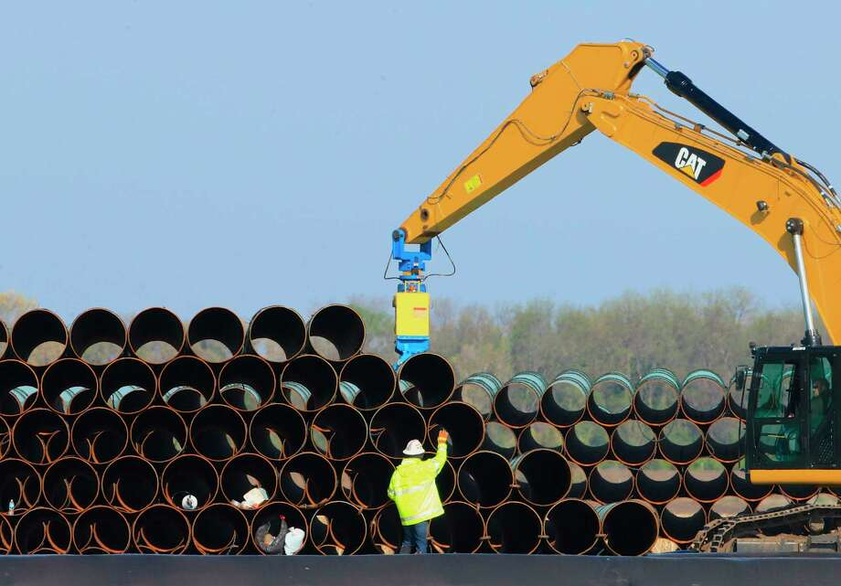 Pipes for the Dakota Access oil pipeline are stacked in South Dakota in 2015. The company behind that pipeline is having a rough go of it at a project in Ohio.  Photo: Nati Harnik, Associated Press / Copyright 2016 The Associated Press. All rights reserved. This material may not be published, broadcast, rewritten or redistribu