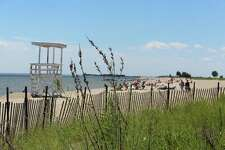 Visitors turned out to Sherwood Island State Park in Westport, Conn. June 20, 2017 despite no lifeguards being stationed at the popular beach on Mondays-Wednesdays.