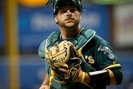ST. PETERSBURG, FL - JUNE 9: Catcher Stephen Vogt #21 of the Oakland Athletics makes his way back to the dugout at the end of the first inning of a game against the Tampa Bay Rays on June 9, 2017 at Tropicana Field in St. Petersburg, Florida. (Photo by Brian Blanco/Getty Images)